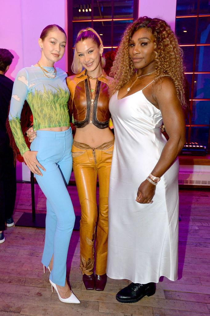 Bella Hadid with Gigi Hadid and Serena Williams at New York Fashion Week in September 2019.
