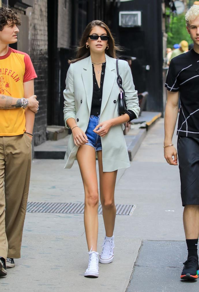 Kaia Gerber in a $190 AUD grey blazer by Mango in June 2019. <br><br> *Image: Getty*