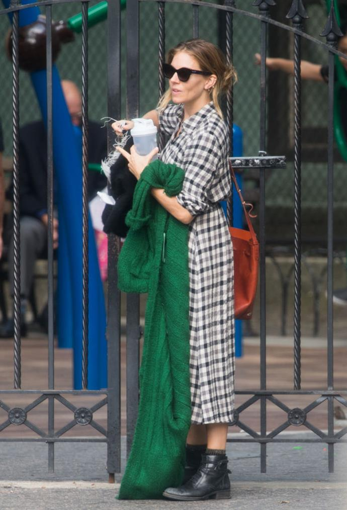 Sienna Miller in a $100 AUD checked dress by ZARA in September 2018. <br><br> *Image: Getty*