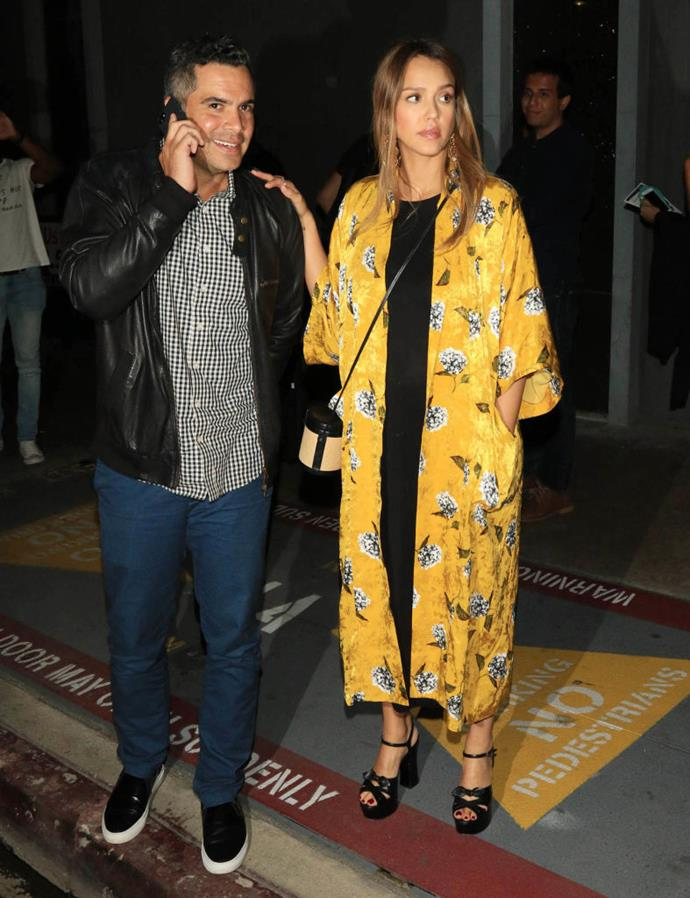 Jessica Alba in a $189 AUD yellow floral-print coat by Topshop in August 2017. <br><br> *Image: Getty*