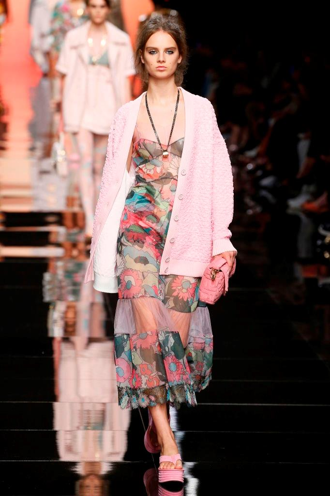 After showing a collection of couture looks that would've looked at home in Michelle Pfeiffer's *Scarface* wardrobe, **Fendi** continued its '70s/early '80s-infused aesthetic, by way of hand-drawn floral prints and platform flip-flops (*yes*, platform flip-flops), under the direction of new creative lead Silvia Venturini Fendi.