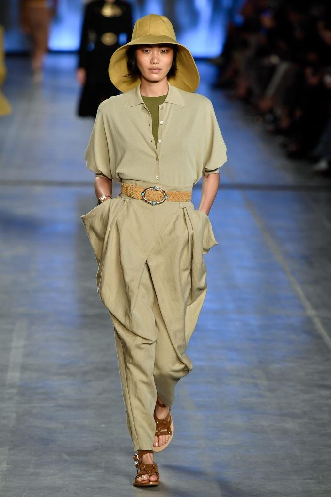 Though many of us associate **Alberta Ferretti** with her stellar red carpet offerings, the designer took a more subtle turn for spring/summer '20, incorporating fashionably protective sunhats and fashion-forward iterations of the boiler suit.