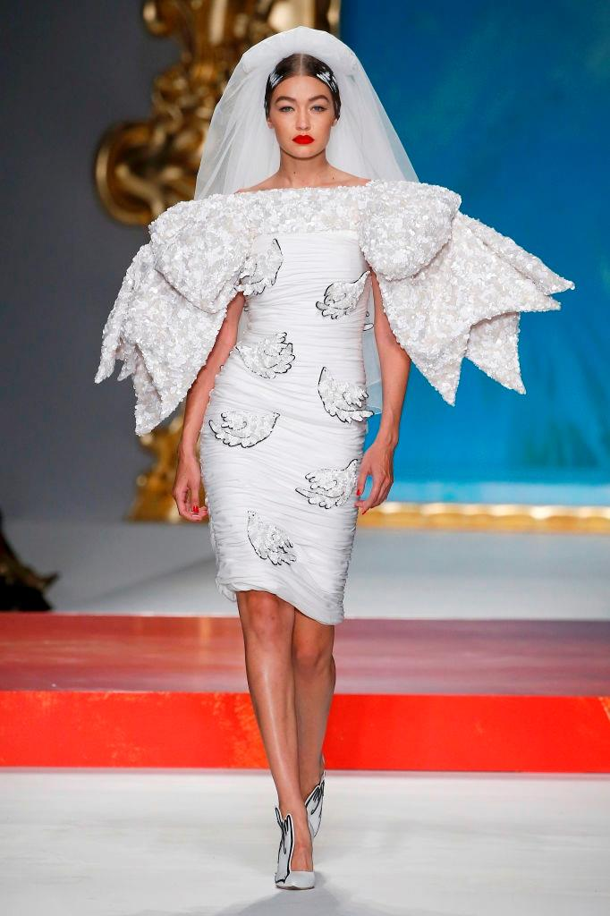 After Scott picked Gigi Hadid to be his **Moschino** bride at spring/summer '19, the model and It-girl once again resumed the role for spring/summer '20, in the kind of fantastical wedding dress only Jeremy Scott could create.