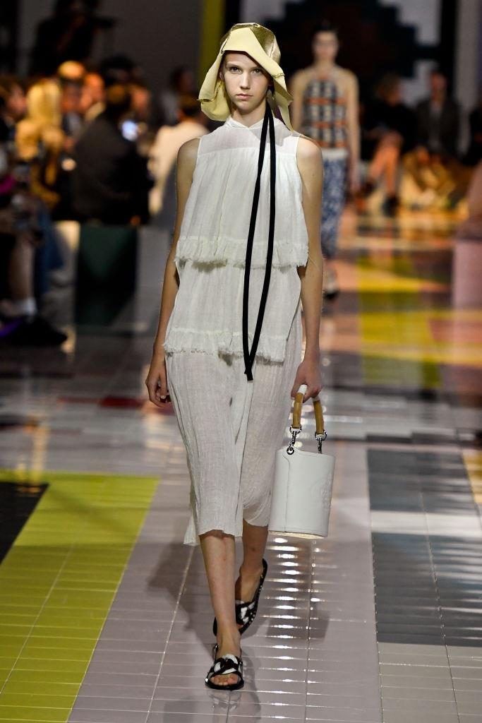 The patterned (and occasionally bedazzled) looks were memorable, but **Prada** spring/summer '20 still embodied the brand's signature simplicity—with monochromatic dresses, bucket bags, and adorably asymmetrical hats.