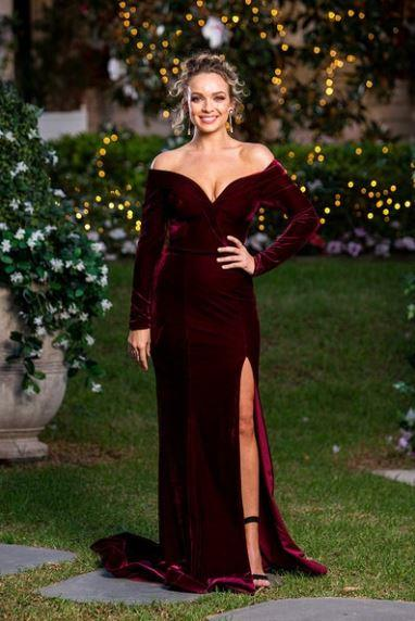 *Abbie in Tina Holy*<br><bR> The fit of this velvet gown on Abbie, coupled with her relaxed curly bun, puts a different, more exciting spin on the traditional 'sexy dress.'