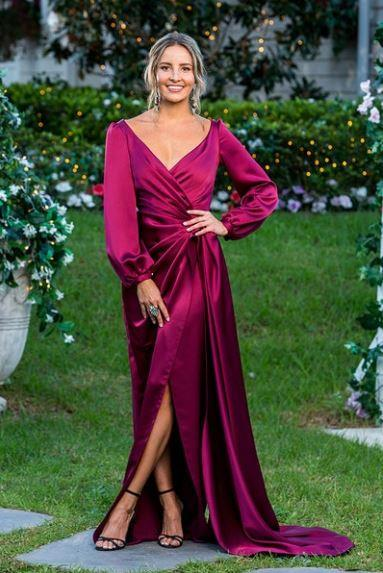 *Kristen in Gemeli Power*<br><br> The romantic touches on this punchy raspberry Gemeli Power gown, like its cuffed sleeves, wrapped waist and deep-v neckline, set it apart during the episode.