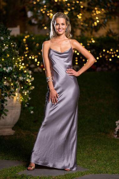 "*Helena in Natalie Rolt*<br><br> The appeal of a simple slip strikes again. The gunmetal tone of this ultra-thin slip by Natalie Rolt ([also worn in red](https://www.elle.com.au/fashion/bachelor-australia-2019-same-dress-21328|target=""_blank"") by Monique in a different episode) suits her colouring nicely. However, we do wish the hair wasn't so aggressively slicked back as the *Something About Mary* association is strong."