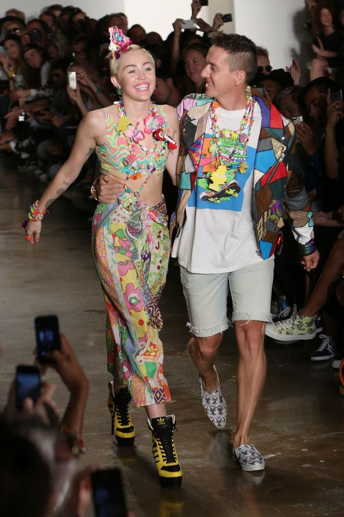 """**Miley Cyrus for Jeremy Scott spring/summer 2015 at New York Fashion Week**<br><br>  Miley Cyrus took to the runway in 2014 to show off her [jewellery collaboration](https://www.elle.com/fashion/news/a15461/miley-cyrus-jeremy-scott-interview/