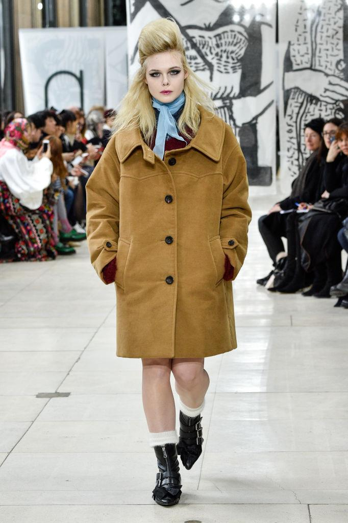 **Elle Fanning for Miu Miu autumn/winter 2018/2019 at Paris Fashion Week**<br><br>  Miu Miu face Elle Fanning made her first-ever runway cameo at the fashion house's autumn/winter 2018/2019 show at Paris Fashion Week. The *Maleficient* actress not only opened the show (a spot typically reserved for top models or rising new faces), but she nabbed the coveted closing spot as well.