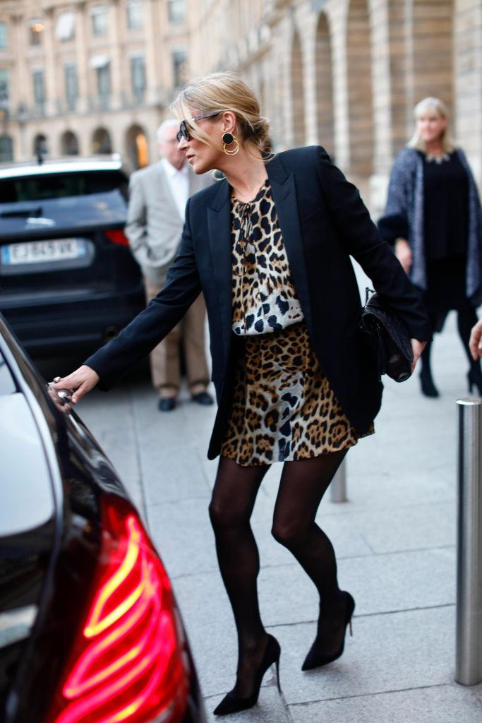 In a leopard print mini-dress and blazer in September 2017.
