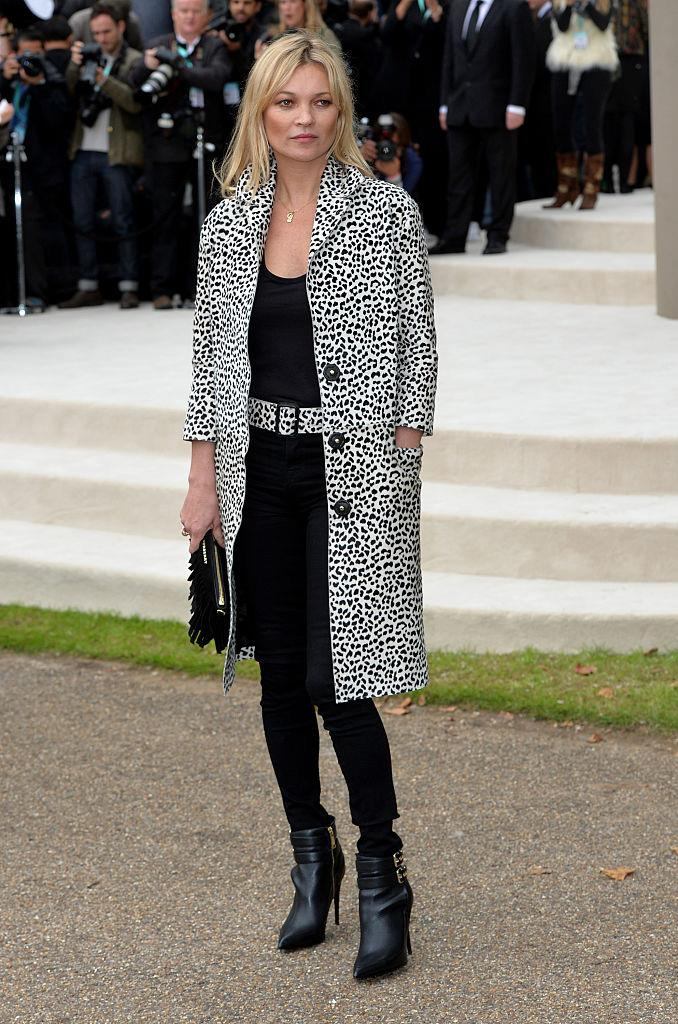 In a leopard print buttoned coat at Burberry's spring/summer '16 show in September 2015.