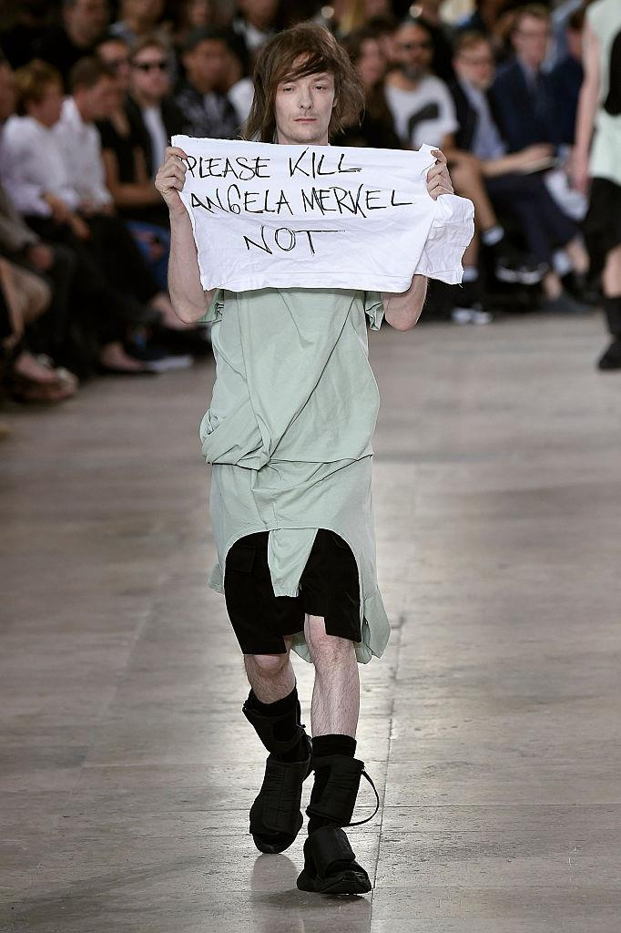 "**Rick Owens spring/summer '16** <br><br> Things went slightly awry at Rick Owens' spring/summer '16 presentation when a model walked the runway holding a white t-shirt with the words ""PLEASE KILL ANGELA MERKEL NOT"" written in black marker. <br><br> The label publicly disclosed that the strange statement ""does not reflect the opinion of the house of Rick Owens."" Multiple news outlets including *[The Guardian](https://www.theguardian.com/fashion/2015/jun/25/protest-jera-rick-owens-show-kill-angela-merkel-not