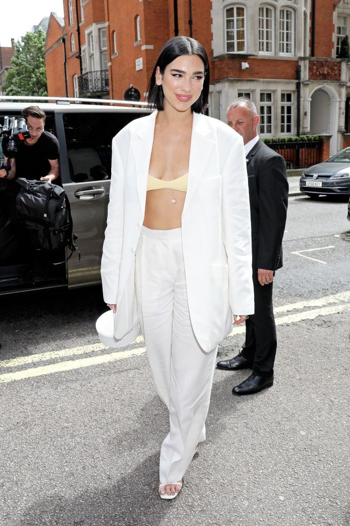 Dua Lipa wearing a yellow bra under a Jacquemus blazer in July 2019.