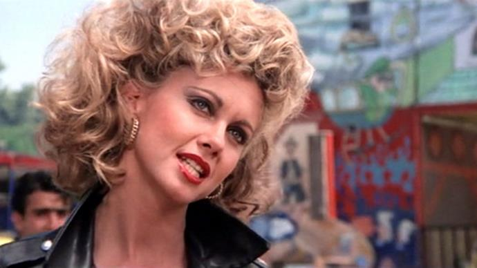 **Olivia Newton John's 'bad girl' perm in** ***Grease***<br><br>  Who could forget the moment that Olivia Newton John's Sandy stepped out near the end of *Grease* with her freshly coiffed 'bad girl' perm? No one, that's who.