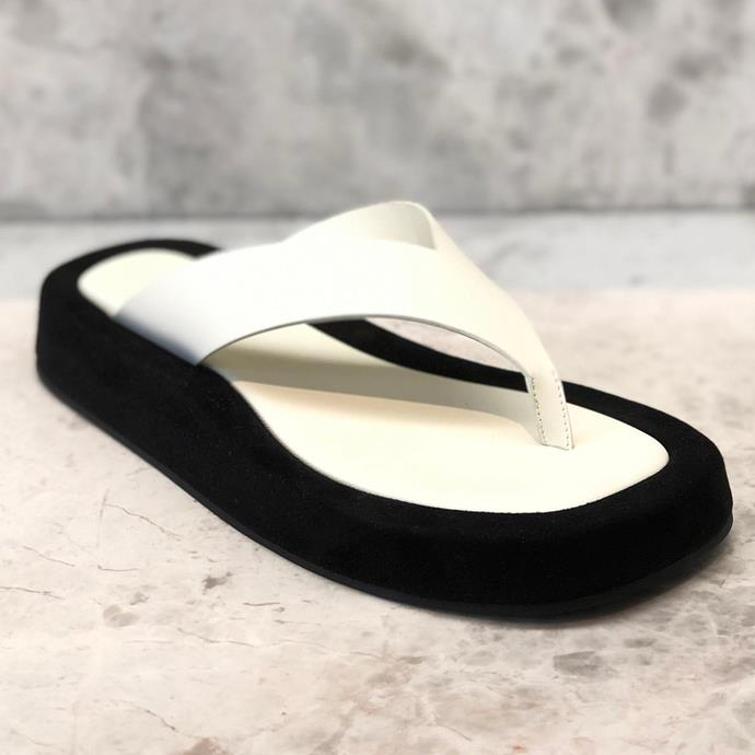 "**The Platform Flip-Flop**<br><br>  ""[This is] my ultimate summer sandal. This is a more edgy version of the flip-flop. The flat-form adds an interesting silhouette to your look. Team it with Bermuda shorts or a sleek minimal dress,"" said Tran."