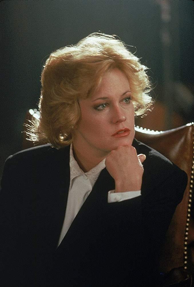 """**Melanie Griffith's 'serious' hair in** ***Working Girl***<br><br>  After commencing the film with an all-out '80s bouffant, Tess (Melanie Griffith) traded in her mullet for a more """"professional"""" cut in order to rise up the ranks of New York's competitive investment banking scene."""