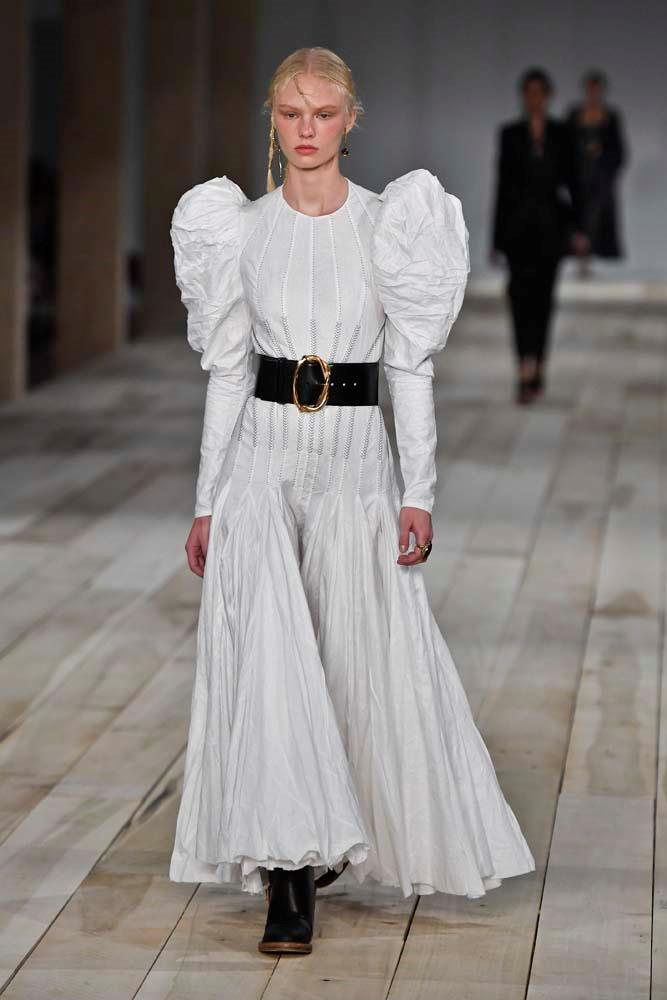 "***Alexander McQueen***<br><br> ""The combination of the theatrical sleeves, corset waist and ankle-grazing hemline is taken to the next level (although I didn't know there was another level) by the slightly undone hair and grunge-y accessories."" Samantha Wong, market editor."