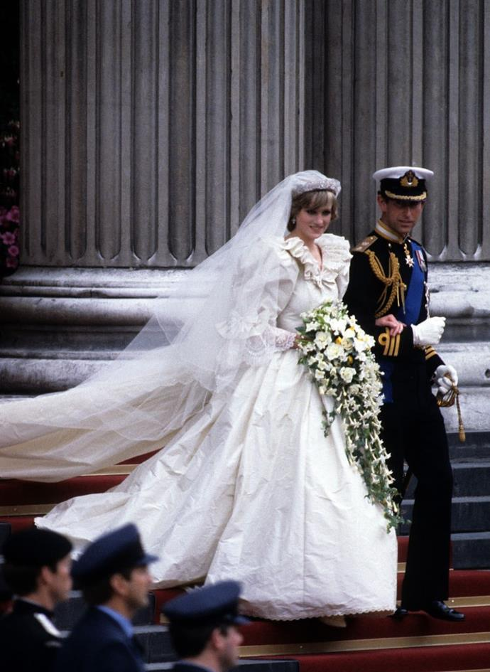 ***Diana, Princess of Wales in David and Elizabeth Emanuel (1981)*** <br><br> At only 21 years old, Diana Spencer wed Prince Charles at St. Paul's Cathedral in London, and wore an iconic maximalist gown by David and Elizabeth Emanuel. The frilled sleeves and seven-metre-long train later became synonymous with the gaudiness and excess of the 1980s.