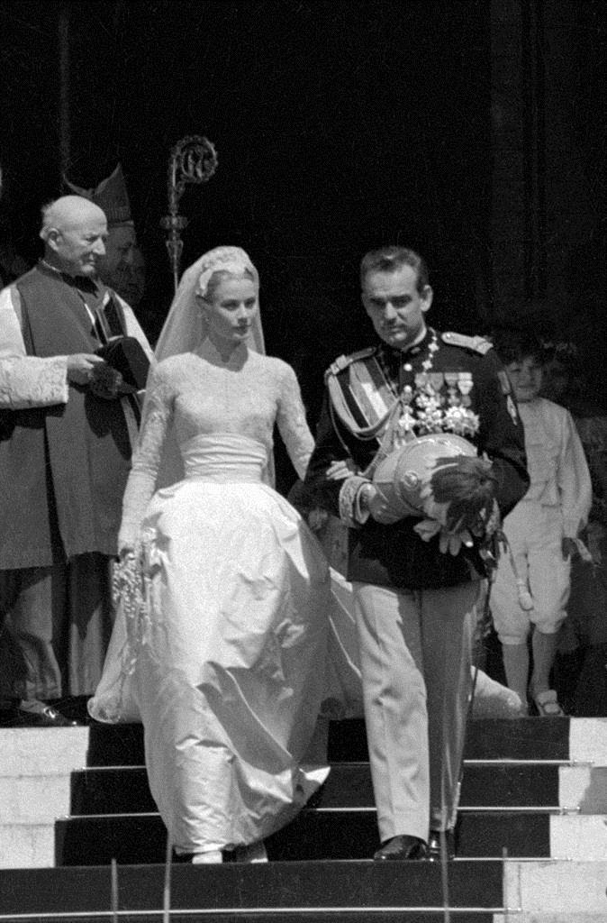 ***Grace Kelly in Helen Rose (1956)*** <br><br> The whole world watched on as Hollywood actress Grace Kelly married Prince Rainier III of Monaco, wearing a timeless lace gown by Helen Rose that was seamlessly cinched at the waist.