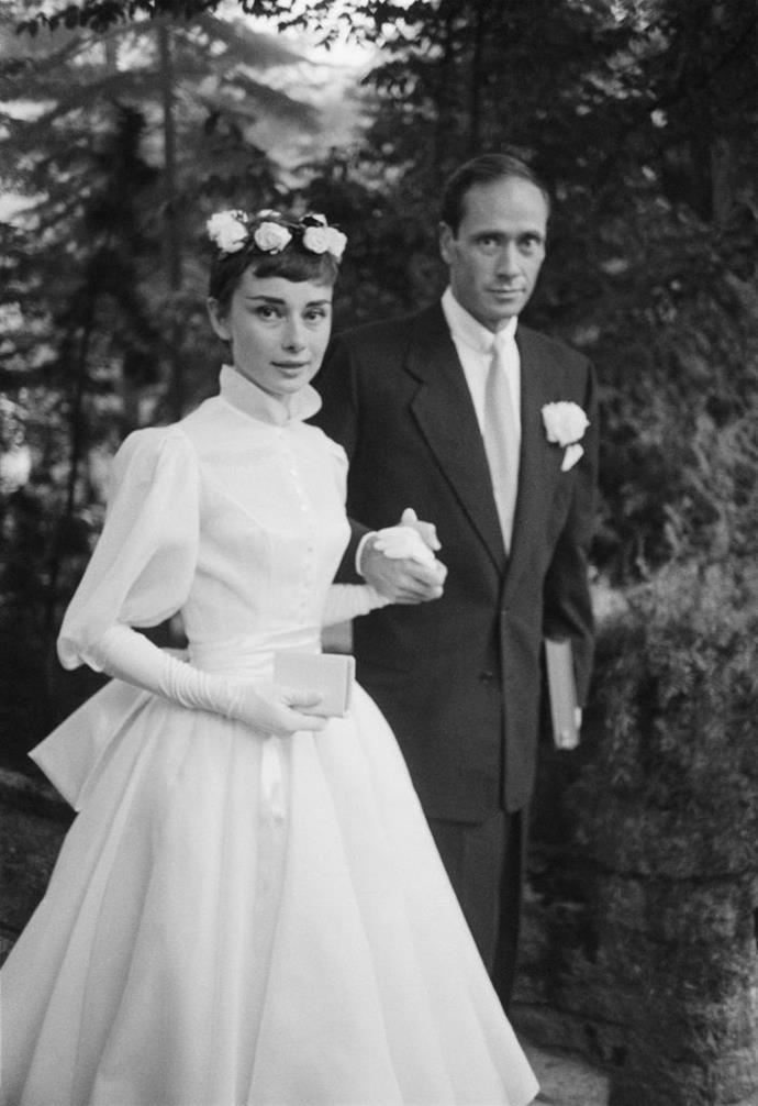 ***Audrey Hepburn in Balmain (1954)*** <br><br> In the 1950s, Audrey Hepburn was the most famous actress in the world. For her 1954 marriage to actor Mel Ferrer, her bespoke Balmain gown (featuring a divine floral headpiece) inspired brides for decades to come.