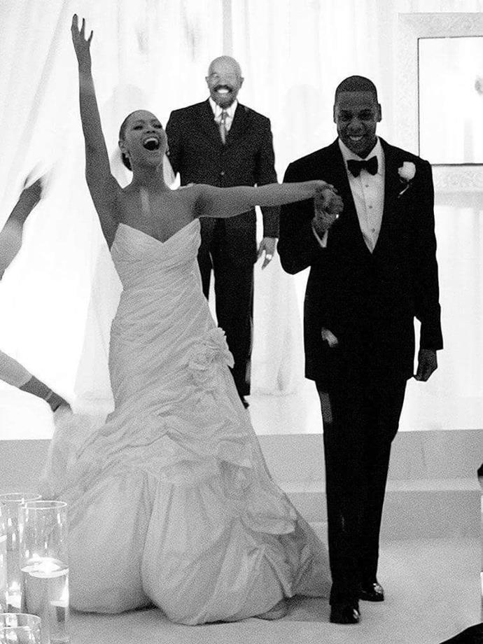 ***Beyoncé in a custom design by Tina Knowles (2008)*** <br><br> Musical power couple Beyoncé and Jay-Z kept their New York wedding as private as possible, but a handful of pictures were eventually released showing Beyoncé's timeless, deep-cut gown (which was actually designed by her mother, Tina Knowles).