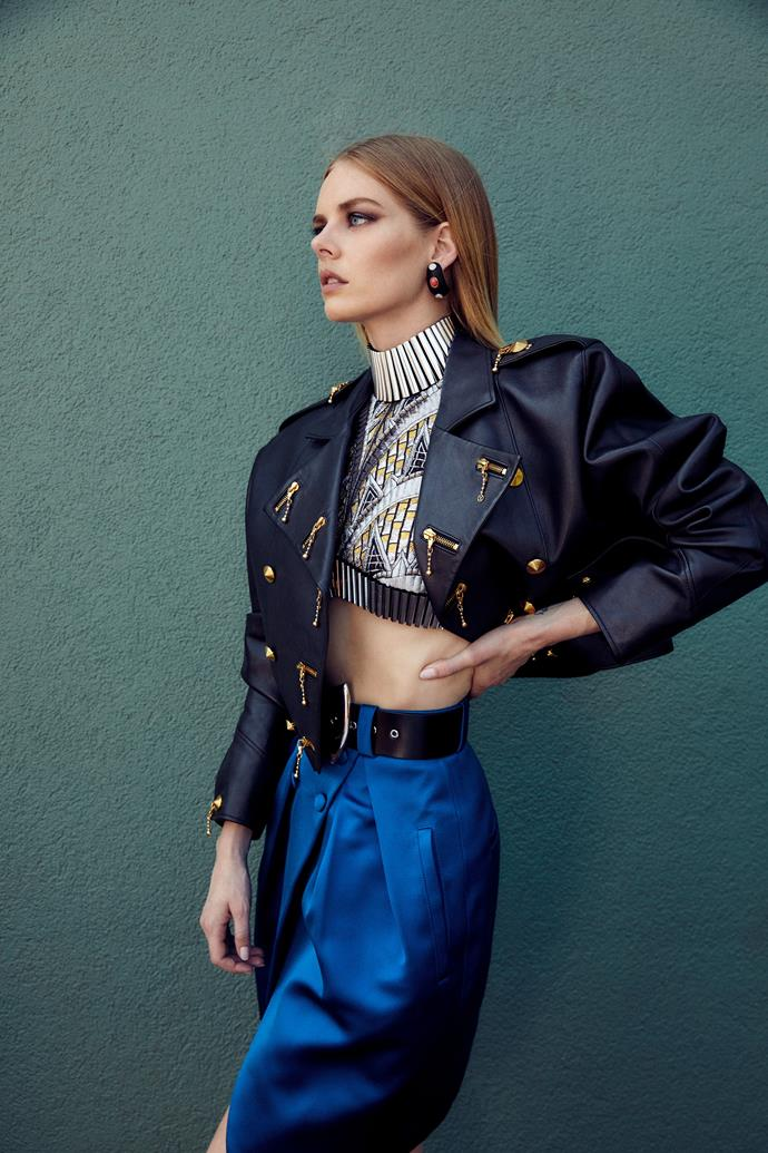 Louis Vuitton jacket, top, skirt and earrings, all price on application, and belt, $940.