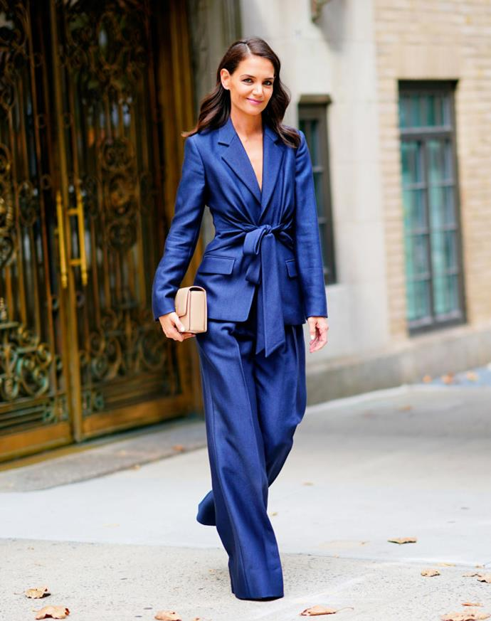 Wearing a metallic navy power suit by Gabriela Hearst with loose waves on September 26, 2019.