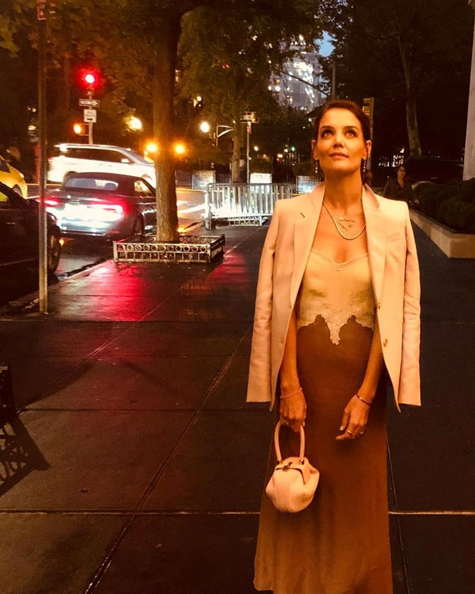 "In a blush-and-ivory slip dress by Gabriela Hearst on October 5, 2019.<br><br>  *Image via [@katieholmes](https://www.instagram.com/p/B3LGq5Inzhj/|target=""_blank""