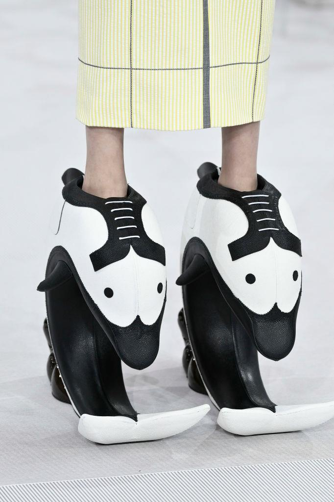 """Directional designer Thom Browne's spring/summer 2020 runway show had everyone talking for its vertiginous dolphin """"pedestal shoes""""."""