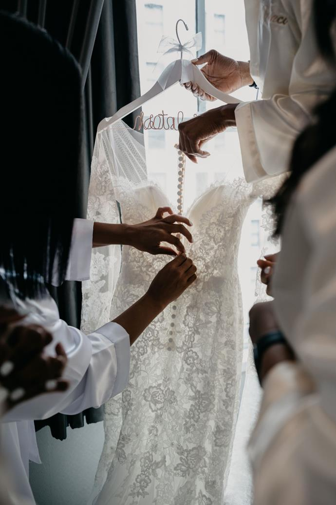 **On finding the dress:** It was extremely important for me to have a gown that was full lace, a dramatic lengthy train, and long sleeves. I tried on at least 50 gowns until I settled on a beautiful Pronovias gown from Designer Loft Boutique in NYC.
