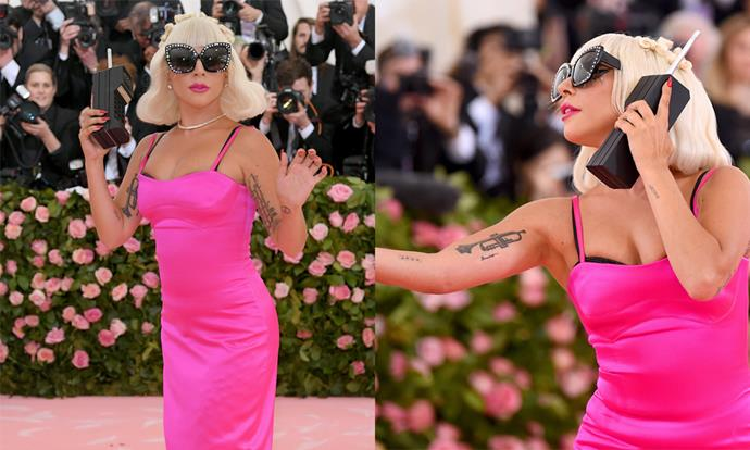 **4. Lady Gaga at the 2019 Met Gala** <br><br> As a co-chair of 2019's 'Camp'-themed Met Gala, Lady Gaga had every reason to deliver, and her four-tiered Brandon Maxwell ensemble didn't disappoint. Arguably the most iconic part of the look was when Gaga stripped down to a hot-pink silk dress, and whipped out a giant mobile phone for a peak-1990s effect.