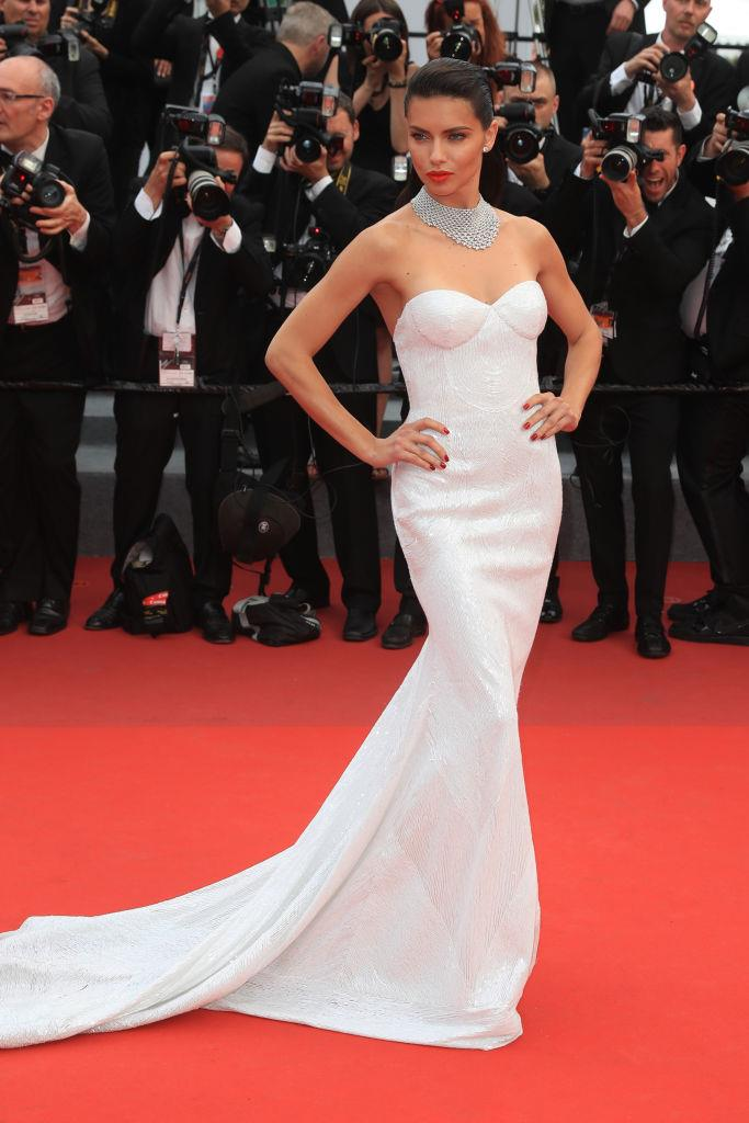 Adriana Lima wearing a strapless wedding dress by Naeem Khan to the Cannes Film Festival in May 2017.