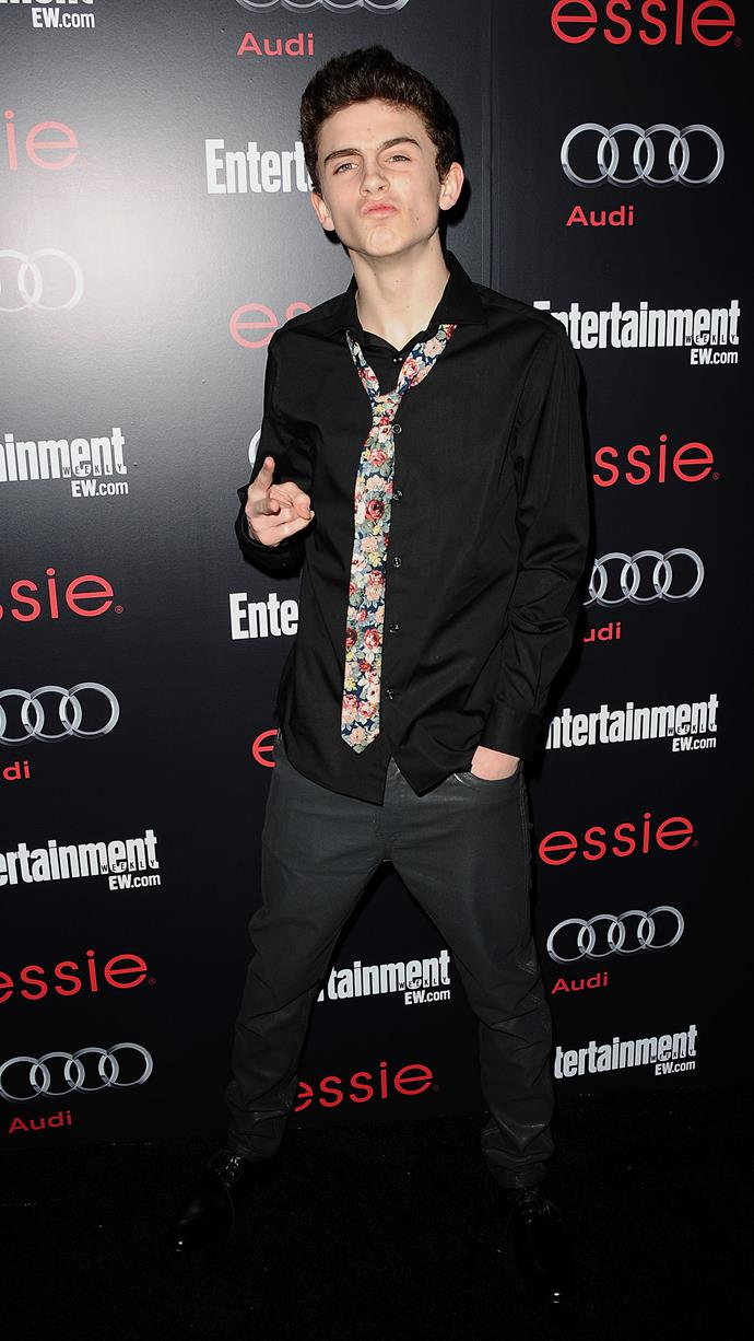 Florals—which were a highly praised mainstay of Chalamet's red carpet wardrobe in 2018—appeared as early as 2013. Here he is at 17 at the *Entertainment Weekly* Screen Actors Guild Awards pre-party on January 26 that year.