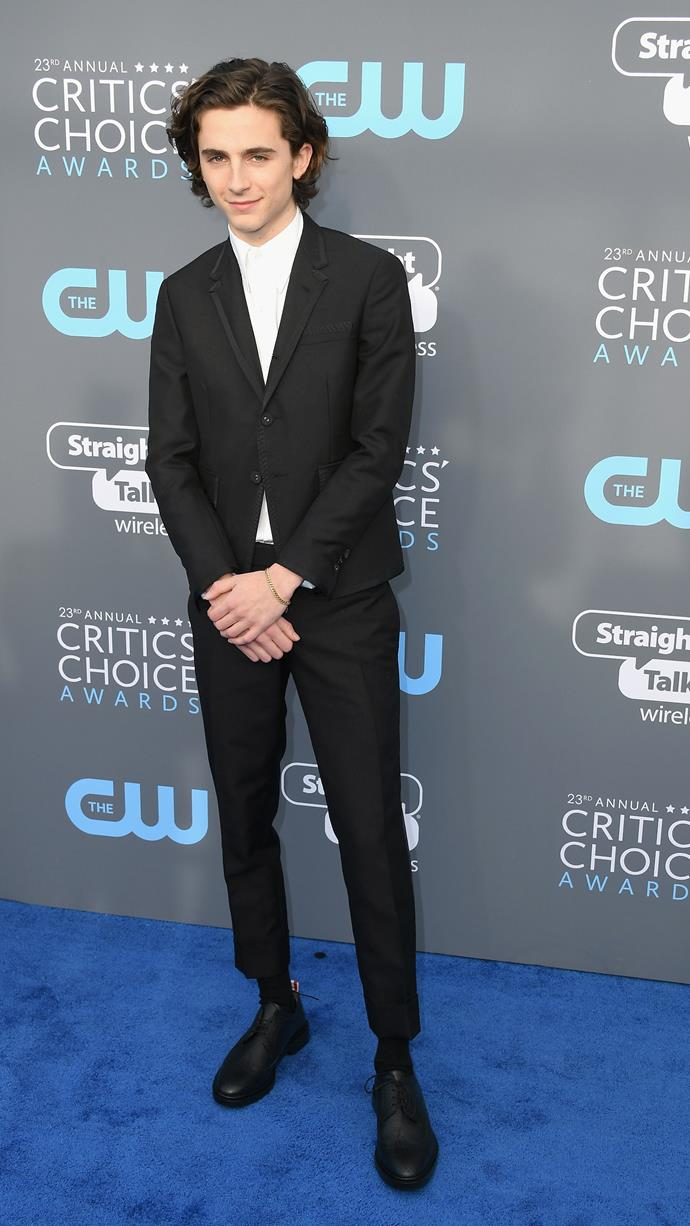 Pants cropped to almost-too-short are becoming a signature. In Thom Browne at the 23rd Annual Critics' Choice Awards on January 18, 2018.