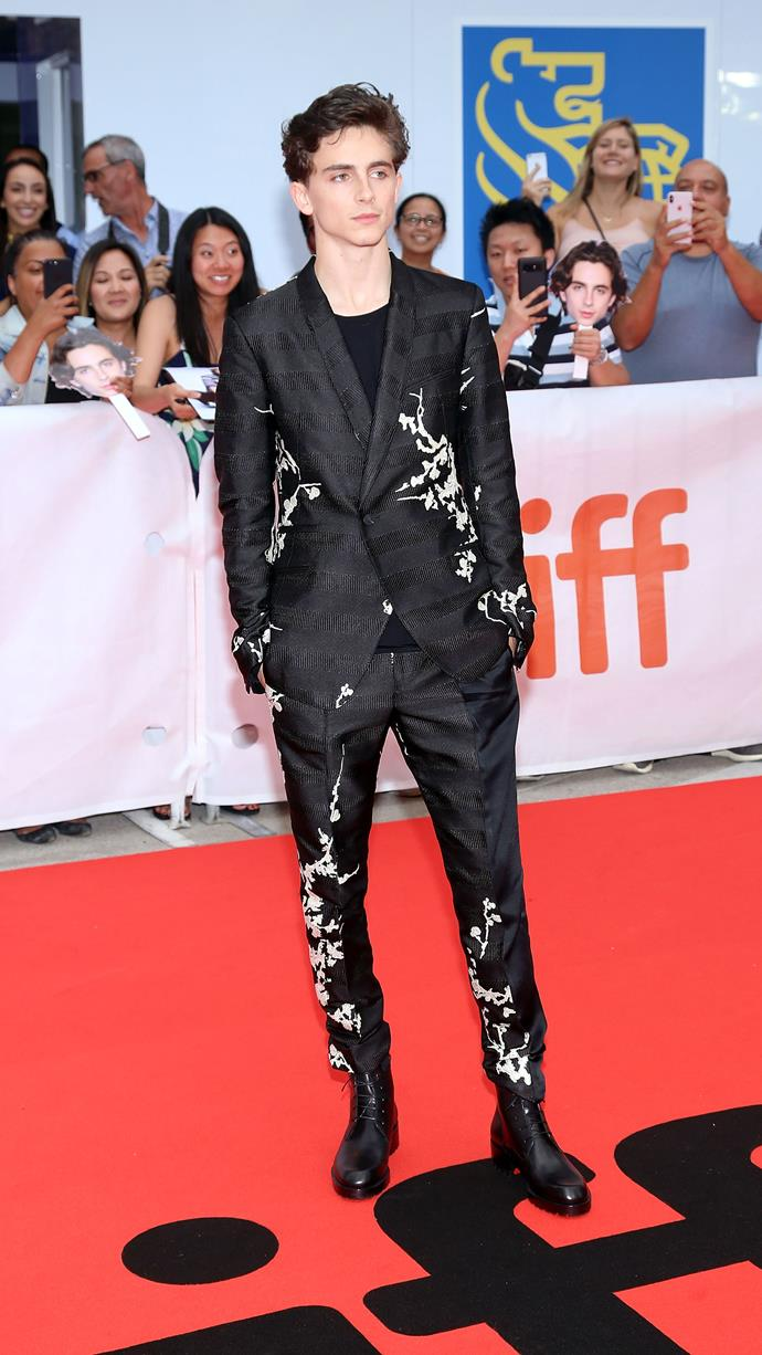 Here's where things start to get really interesting. *The King* bowl cut is growing out and the floral suit motif is in. Haider Ackermann has left Berluti to start his eponymous label, and Timmy has remained loyal. Wearing Haider Ackermann A/W 2018 at the *Beautiful Boy* premiere during the Toronto International Film Festival September 7, 2018.