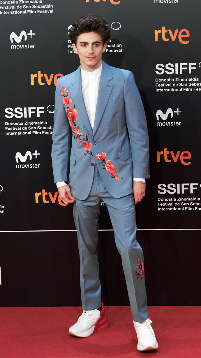 Kicking off his love for Alexander McQueen in a show-stealing powder blue suit with embroidered flowers and birds. (Also ft. a moustache we must never speak of again.) At the premiere of *Beautiful Boy* as part of the San Sebastian International Film Festival on September 24, 2018.