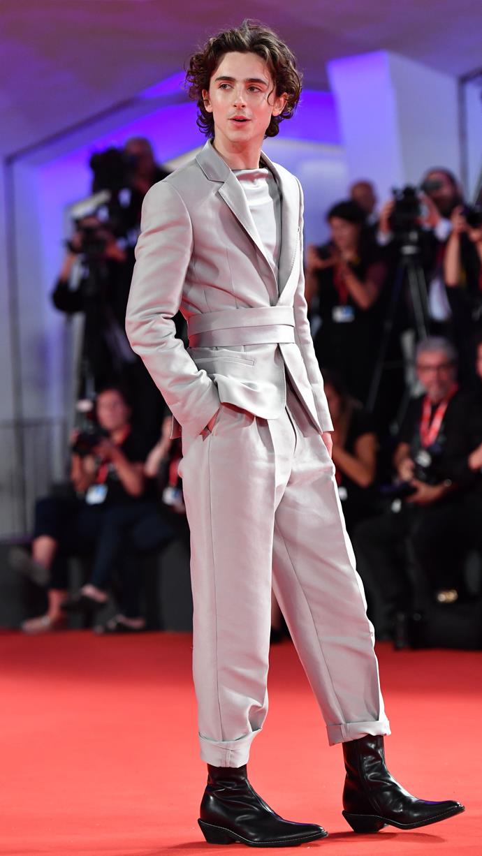 The custom Haider Ackermann suit that divided the internet (also worn before iterations of the same suit appeared S/S 2020 runway) at the world premiere of *The King* at the Venice Film Festival on September 2, 2019.