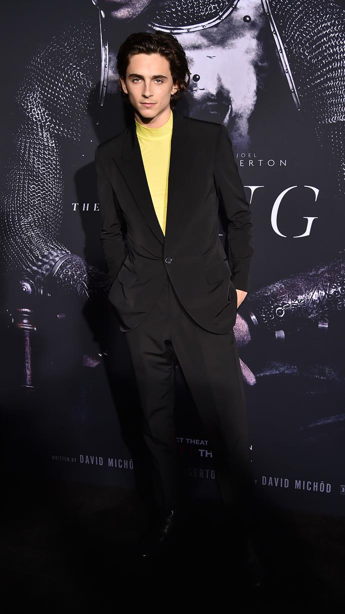 Proving that he's one of the few people who look good in yellow. Wearing Givenchy at the New York premiere of *The King* on October 01, 2019.