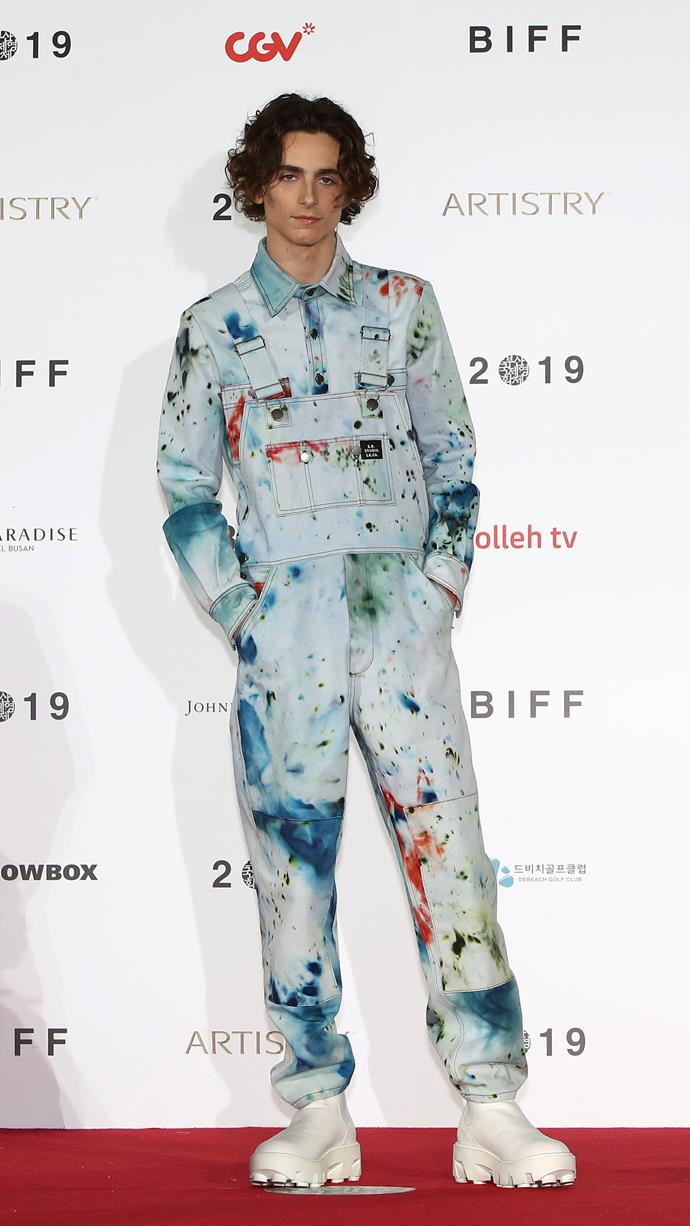 How you'd manage to keep your boots so white if you had really come straight from the studio is a mystery. The S.R. STUDIO. LA. CA. look Timmy found while shooting *Dune*. Here he's in South Korea at the 24th Busan International Film Festival on October 8, 2019.
