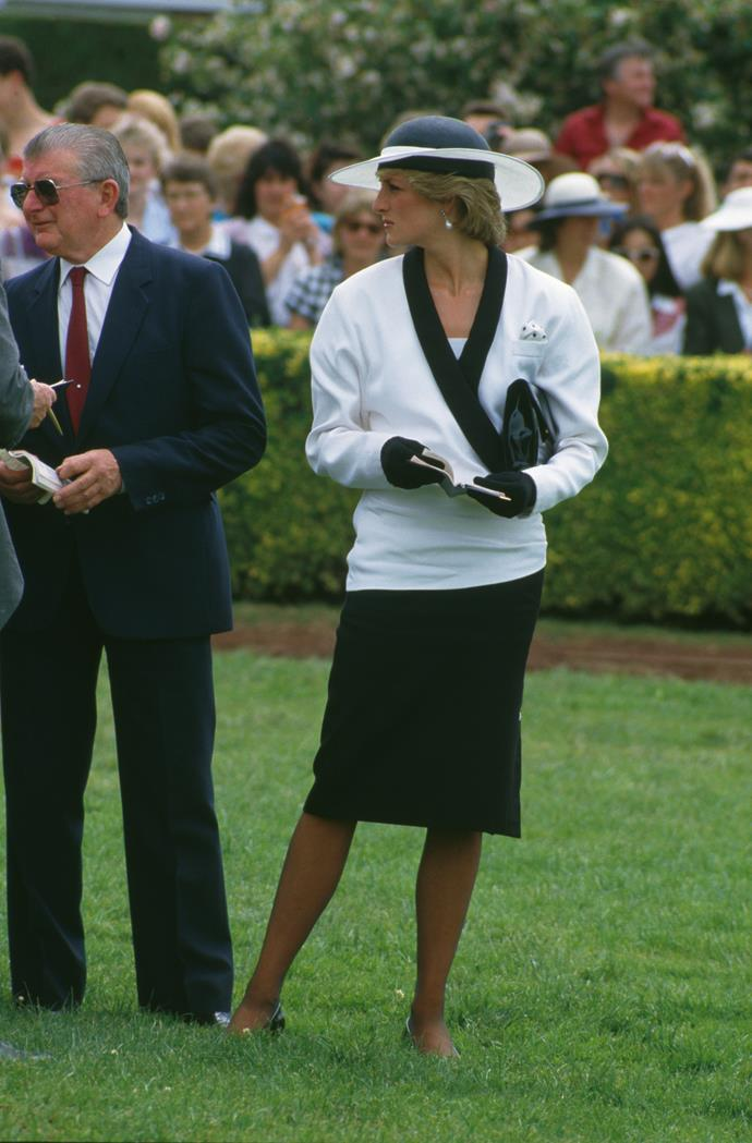 Princess Diana wearing a suit by Bruce Oldfield and a hat by Frederick Fox in 1985.