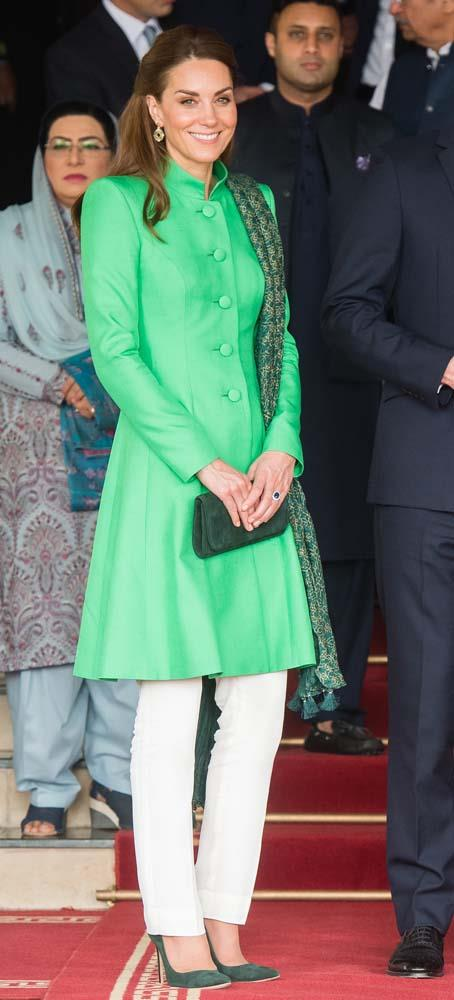 In green Catherine Walker tunic and Maheen Khan trousers in Islamabad.