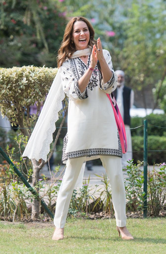 In a black-and-white kurta by Élan with nude heels, in Lahore.