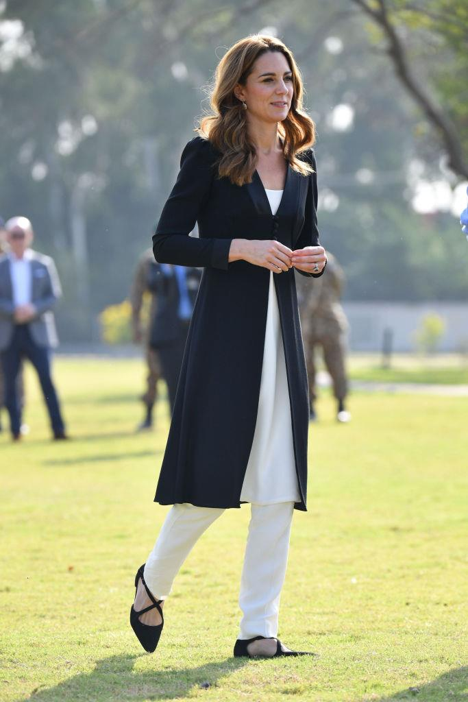 In a black blazer coat by Beulah, with a white blouse, white trousers and Russell & Bromley flats, in Islamabad.