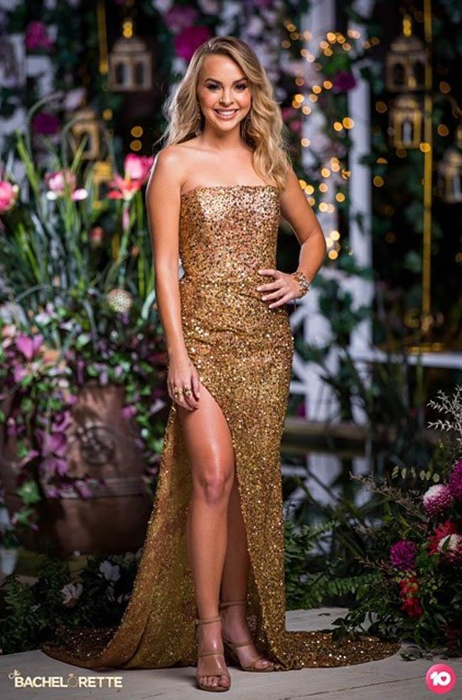"Angie wears a custom gold dress from [By Kinsman](https://www.bkthelabel.com/|target=""_blank""|rel=""nofollow"") in episode 5."
