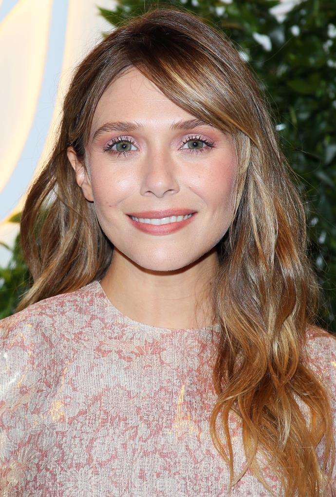 **Elizabeth Olsen**<br> The darker honey shade up top helps to highlight Elizabeth Olsen's gleaming golden ends.