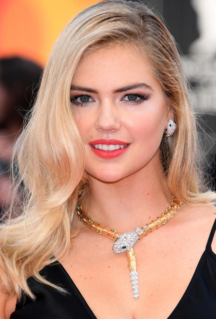 **Kate Upton**<br> A deep side part and cascading waves show off Kate Upton's heavenly highlighted honey.