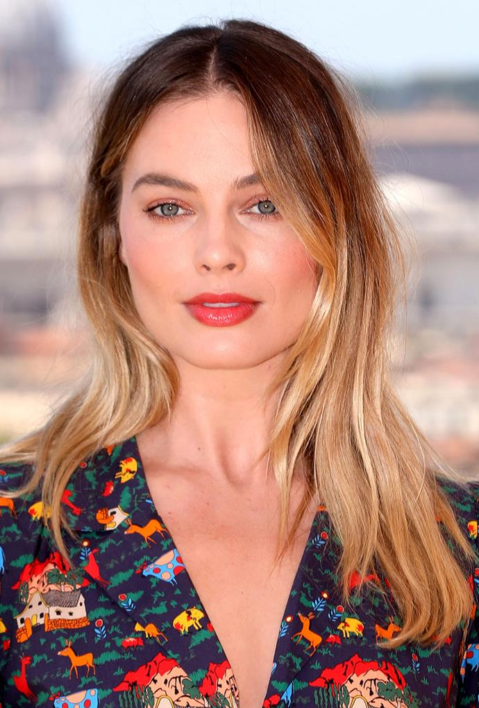 **Margot Robbie**<br> Margot Robbie embraces the lived-in look, letting her ashier roots emphasise the golden honey ends.