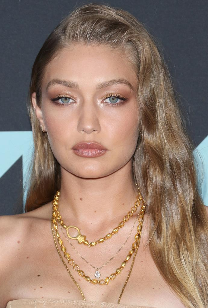 **Gigi Hadid**<br> Gigi Hadid shows off a moodier take on the trend with deeper roots and a honey-dipped balayage look.