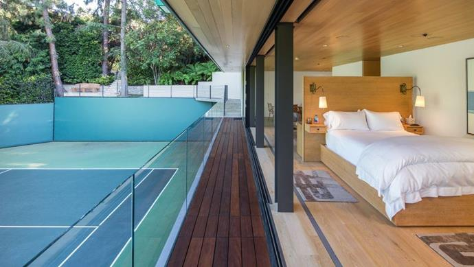 "The tennis court-facing guest house<br><br>  *Image by Tyler Hogan via [Mansion Global](https://www.mansionglobal.com/articles/former-beverly-hills-home-of-jennifer-aniston-and-brad-pitt-asks-49-million-203446|target=""_blank""