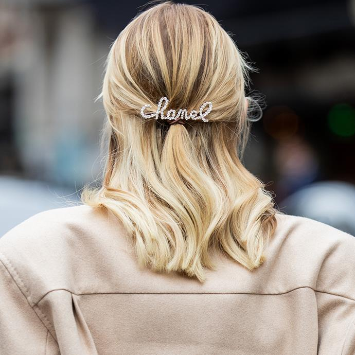 """***A Statement Barrette***<br><br> """"Chanel's embellished barrettes sparked an industry-wide obsession with statement hair clips,"""" says O'Neill. Whether the Chanel variant or a cheekier version from Ashley Williams, say it with a slide."""